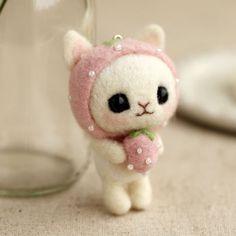 Needle felted kitten with strawberry.  DIY kit on ebay.