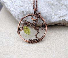 Tree of life wire pendant with green leaf by Ianira on Etsy, €22.00