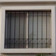 Imagen de rejas en ventanas de herrería