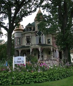 Someone did an excellent job of painting this fantastic house!  The color choices would not be mine, but superbly done!  Architectural features and details should shine like they do here.
