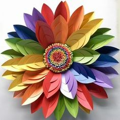 Rainbow paper flower, can be created in any size or incorporated into a backdrop #homedecor #lgbt #lgbtwedding #paperflowers #paperart #gaywedding