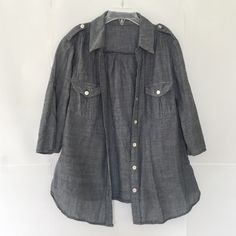 Blue tinted gray 3/4 sleeve shirt Brand: Forever 21. Size: S. The sleeves can be buttoned up to make them short sleeved. Otherwise, it is 3/4 sleeved. Looks great with jeans. Forever 21 Tops Button Down Shirts