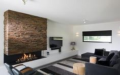 Wonderwall Studios is a creative studio that designs and produces wooden panelling for walls and surfaces. Modern Fireplace, Fireplace Wall, Fireplace Surrounds, Fireplace Design, Reclaimed Wood Paneling, Wooden Panelling, Wooden Wall Panels, Wall Panelling, Panneau Mural Tv