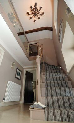 Hallway with carpeted staircase. Roger Oates Shetland Shadow Light - striped stair runner #StairsandStripes