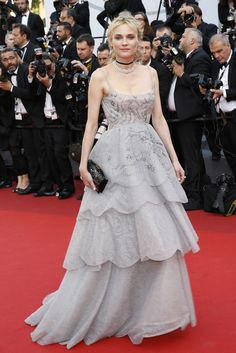 Diane Kruger at the Cannes <i>70th Anniversary</i> Screening  - ELLE.com This dress is horrible for her, who chose it. I don't care if it's Chanel Grey, it washes her out, she looks pale, and colorless. Bad choice of colors.