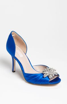 Blue shoe with silver accent.  Also comes in white - found these at Nordstrom and a few other websites.  Out of stock everywhere.