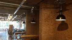 The new Caffe Kix at Vantage London, using Smoked Peach Brick slips and Pedant lighting Industrial Furniture, Lighting, Ceiling Lights, Vintage Industrial Lighting, Home Decor, Feature Wall, Vintage Industrial, Brick, Red Bricks