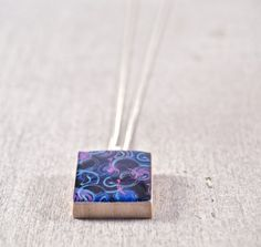 Psychedelic Blue and Purple Circles Scrabble Tile Pendant Necklace on Etsy, $9.00