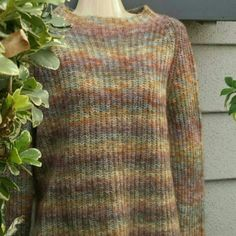 "Muted Colors Sweater High Neck Boxy Knit Sweater. Acrylic/wool blend. Neck opening is 9"" across. It's high necked but not tight. Arms 22"" long. Neck to hem is 22"". Please see photo 2 above for most accurate representation of colors. Jones New York Sweaters Crew & Scoop Necks"