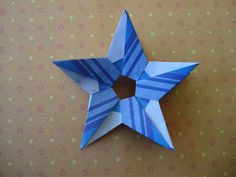 Beautiful origami rings, wreaths, and stars by CARLA ONISHI.  Photo diagrams.