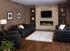 light stone fp wall with flanking open wood sheles, tv above fp