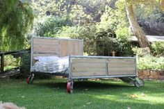 Pictured above is a queen size Scaffold Bed. This is the actual bed for sale, and is truly unique and one of a kind    Masonry scaffolding is modified to a foot board and head board. The panels are made from salvaged hickory flooring. The metal and wood are both sealed and coated. The whole bed rests on 8 locking scaffold casters.    The bed is built as a platform and does not require a box spring. 2x10 slats are included in the price of the bed which creates the platform that the mattress…