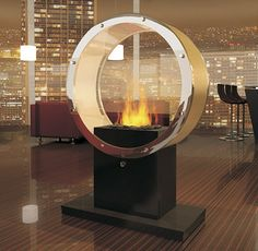 Taking the traditional fireplace to a new level of cool, the Orbiter pedestal fireplace by Digifire will have you spinning in circles! This modern smokeless fireplace features a circular...