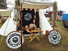 Viking Camp Set Up - Furs, Flag & Shields add a lot to it.
