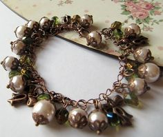 Copper bracelet and matching earrings, pearls, charms, dangle, green