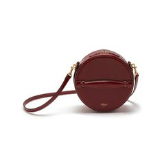 Shop the Trunk Bag in Crimson Leather at Mulberry.com. Inspired by a vintage hat box and finished with a beautifully-crafted bombe handle, the new Trunk Bag has a neat and nostalgic silhouette with refined hardware and detailing. First introduced on the London Fashion Week catwalk, the Trunk Bag has a versatile detachable strap and sumptuous quilted lining.
