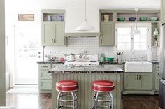 craftsmen kitchen with olive green cabinets, olive gray, sage green, gray-green, green-gray, army green, grunge green, white kitchen, red bar stools, metal legs, sherwin williams acier