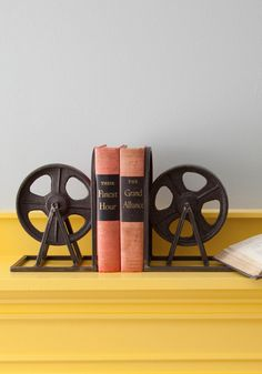 Film Industrial Bookends: Featuring a welded metal frame around a cast iron wheel - which could be inspired by an retro film reel or a backstage pulley / Modcloth