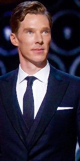 Benedict Cumberbatch at the Oscars 2014. He is clearly and visibly taking the time out to process and appreciate the fact that he has made it on stage at the Oscars...