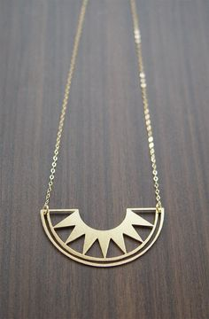 rising sun gold necklace by friedasophie