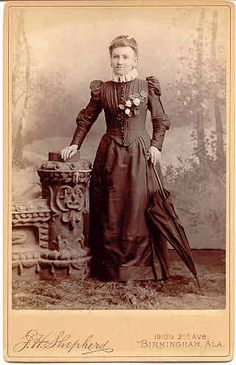 VICTORIAN lady with a parasol that matches her outfit.