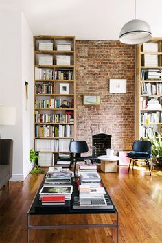 Brick fireplace flanked by bookshelves