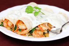 verde shrimp enchiladas with jalapeno cream sauce...this website is a fave!!