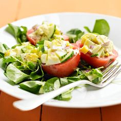 Tomato Egg Salad- Roma tomatoes filled with creamy egg salad and a tangy cucumber mixture top crisp greens