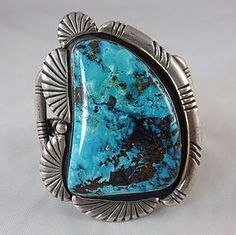 Huge slab of Blue Diamond turquoise is set in sterling silver as a cuff bracelet by a talented Navajo silversmith. This is a nice setting to showcase the awesome turquoise.