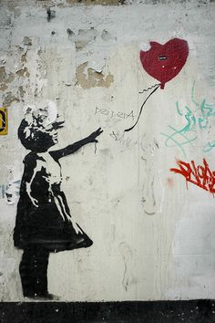 Banksy: Girl with the Red Balloon  When artworks are painted on the buildings, rather than on a canvas, they are subjected to daily wear and tear. So in the years after street artist Banksy painted it, it became hidden by billboards and some of the paint peeled off. Earlier this year a company removed the piece to restore and then sell it. The episode has raised questions about who owns street art and whether its restoration is in the public's best interest.