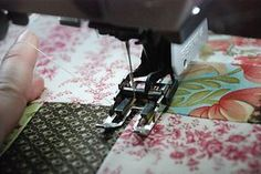 Machine quilting tutorial - including spray basting, how to bring your bottom thread to the top of the quilt, how to use your walking foot, and how to free motion quilt.