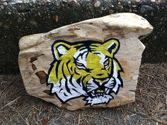 Hand Painted LSU Tigers logo on Mississippi Petrified Wood.           #artsandcrafts #petrifiedwood #fossil #rock #minerals #handpainted #originalart #nature #decor #naturedecor #crafts #art #Tigers #NCAA #football #LSUfootball #Tigersfootball #Louisianastate #LSU