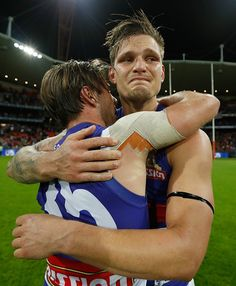 Caleb Daniel and Clay Smith of the Bulldogs celebrate during the 2016 AFL First Preliminary Final match between the GWS Giants and the Western...