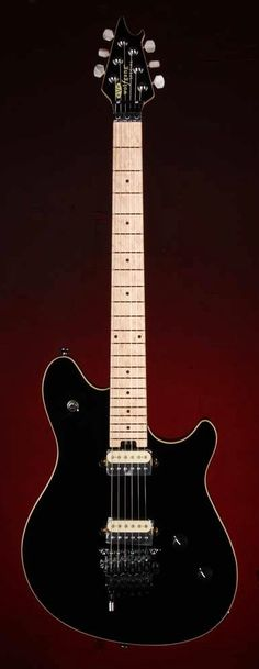 EVH Wolfgang Special Black electric guitar with EVH-Branded Floyd Rose Locking Tremolo with EVH D-Tuna | Small White Mouse