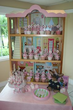 For my daughter's baby shower we used this doll house to display the cupcakes.