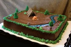 Outdoor / Camping Cake Tent is chocolate (2pcs dried flat then put up). Pretzel stick trees and piping gel river. Pretty easy to make and...