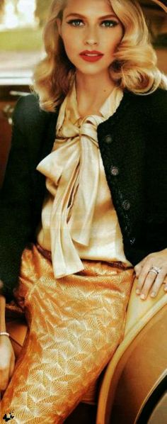 Gold top and skirt toned down with a cropped black cardigan
