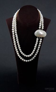 Neptune White II - Chic and modern this dual-strand charmer is crafted from classic white potato-shaped pearls. Fashioned together with an illustrious mother-of-pearl shell clasp; featured here as a pendant.