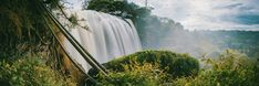 Timelapse Photo of Water Falls Between Trees  Free Stock Photo