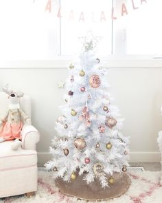 Mini Christmas Tree in White color - Home Decorating Trends - Homedit Mini Christmas Tree in White color - Home Decorating Trends - Homedit<br> Mini Christmas Tree in White color Christmas Tree Design, Small White Christmas Tree, Mini Christmas Tree Decorations, Ribbon On Christmas Tree, Little Christmas Trees, Christmas Colors, Winter Christmas, Christmas Tunes, Christmas Mantles