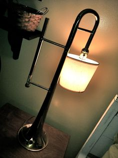 old trumpet- re-purposed to be a lamp by my bed
