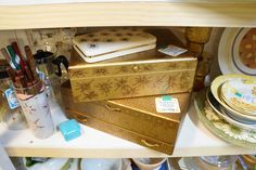 Decorated vintage jewelry boxes with hand-drawn designs.