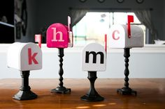 DIY~ Painted and monogrammed mailboxes on candlesticks - imagine making these as a way for your family to give encouraging notes to one another...or for valentines & secret santas.