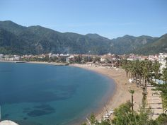 Icmeler Beach, Marmaris - This glorious beach is set within peaceful surroundings and is filled with fine golden sands. It lies next to crystal clear waters and enjoys a variety of water sports.