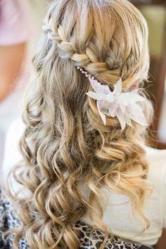 Tousled waterfall bridal hairstyle with a floral headpiece is so pretty! Waterfall Braided Wedding Hairstyles
