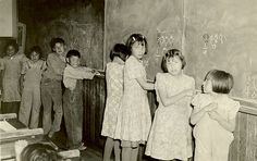 Boys and girls at the blackboard, Morley Indian Residential School, 1945.