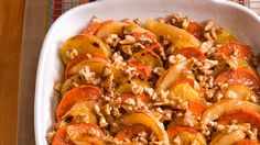 Skip candied yams for this unique casserole, which showcases delectable layers of sweet potatoes, yams, and fresh pears, drizzled with maple syrup and topped with crunchy walnuts.