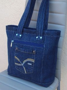 Best 12 Embroidered denim bag Jeans bag with ribbons embroidered Recycled fabric sac Summer floral purse Shoulder bagful Eco friendly tote bag – SkillOfKing. Denim Tote Bags, Denim Purse, Denim Flowers, Old Jeans, Denim Jeans, Recycle Jeans, Bag Patterns To Sew, Denim Bag Patterns, Patchwork Bags