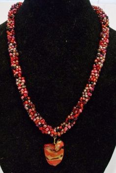 handmade-crochet-black-red-and-gold-beaded-arrowhead-necklace