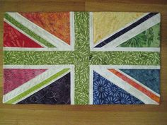 Rainbow Union Jack by Get Stitchy With Sarah, via Flickr pattern found at http://www.fourtwinsisters.com/quiltpatterns/2006/union_jack.pdf